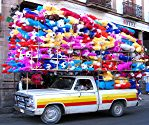 Pinatas being delivered by pickup